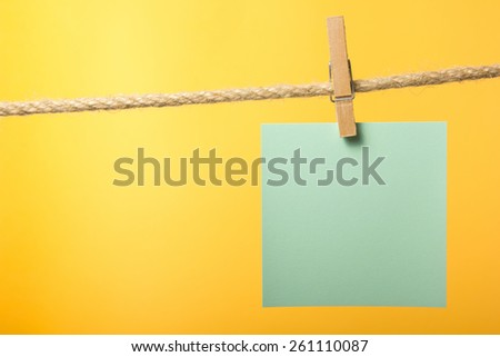 Blank paper notes hanging on rope with clothes pins, copy space for text or image or product placement. Reminder