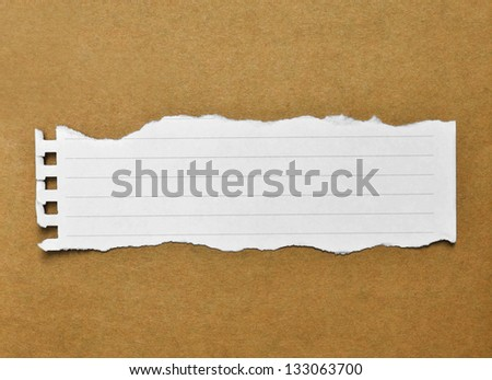 blank paper on brown background - stock photo