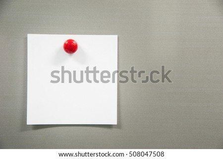Blank paper on refrigerator door with red magnet right frame