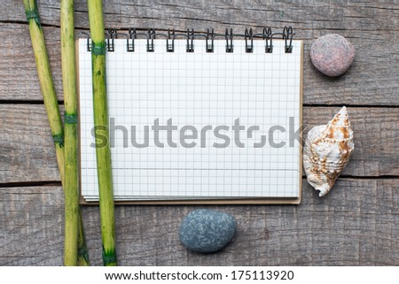 Blank paper on wooden table with bamboo - stock photo
