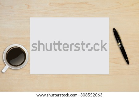 Blank paper page, note paper,coffee, cup with pen on wood table with text space