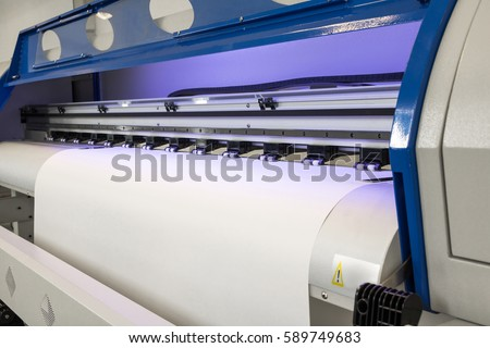 Blank paper roll in large printer format inkjet machine for industrial business.