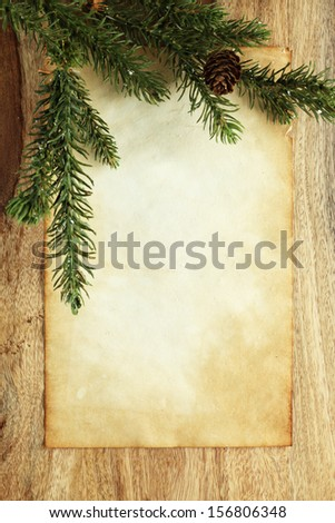 Blank paper with Christmas decorations - stock photo