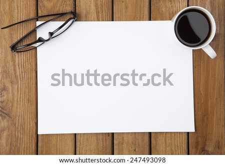 Blank paper with glasses, coffee and cookies - stock photo