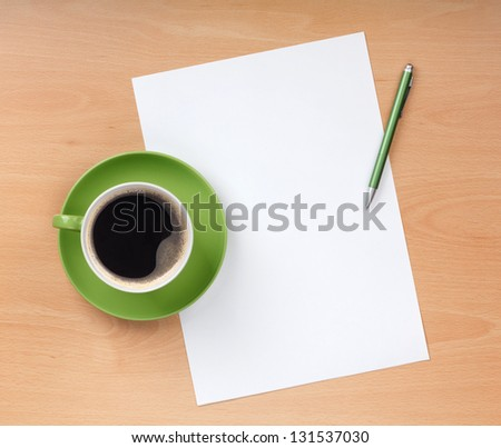 Blank paper with pen and coffee cup on wood table - stock photo