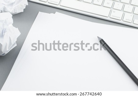 Blank paper with pencil - stock photo