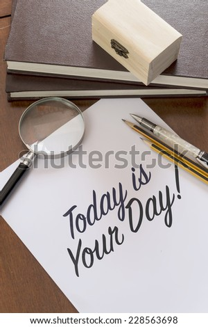 Blank paper with phrase Today is your day on desk - stock photo