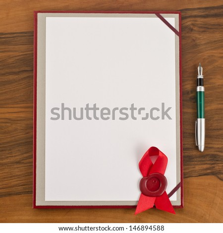 Blank paper with red wax seal and pen on wooden background  - stock photo