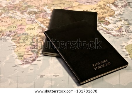 Blank Passport with the world map in the background - stock photo