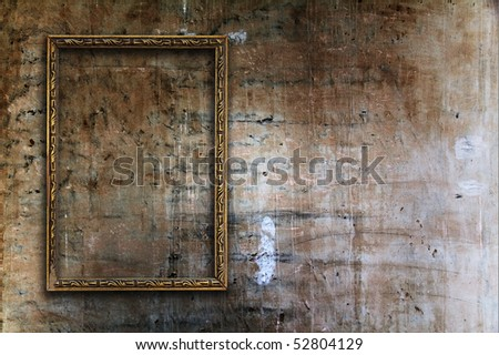 blank photo frame on old wall