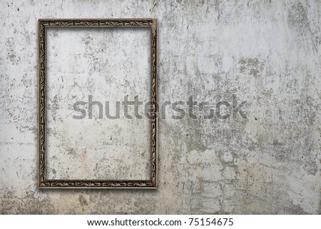 blank photo frame on old wall - stock photo