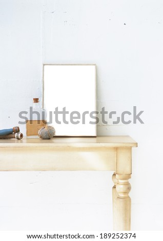 blank photo frame on the table - stock photo