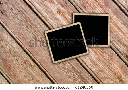Blank photo frame on wood background