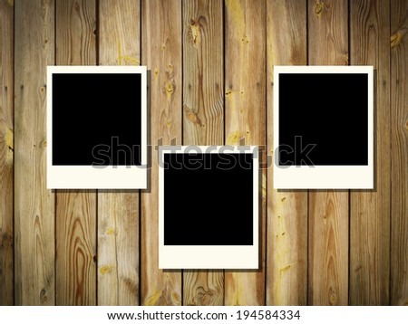 blank photo frame on wood plank background