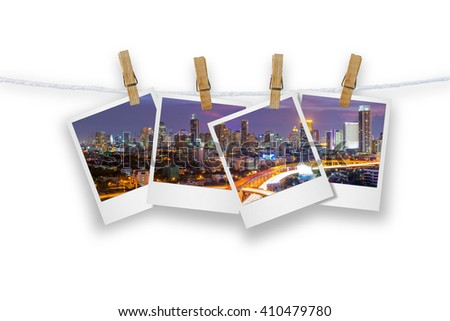 Blank photo frame  with clothespin hanging, photo cityscape and transport of Bangkok, Isolated on white with clipping path.