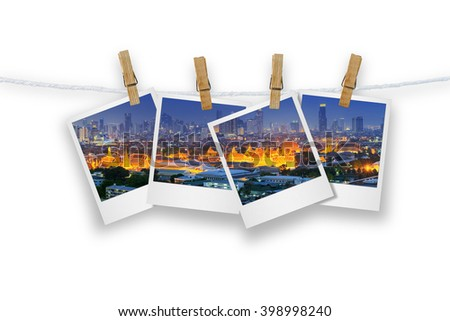 Blank photo frame  with clothespin hanging, photo cityscape skyscrapers of Bangkok, Isolated on white with clipping path. - stock photo
