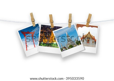 Blank photo frame  with clothespin hanging, photo landmark of Bangkok, Isolated on white with clipping path.