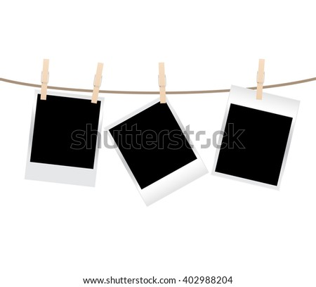 blank photo frames on a clothesline isolated on white background