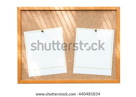 Blank photo frames on cork board with window shadow isolated on white background. - stock photo