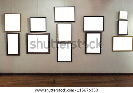 Blank photo frames on gallery wall