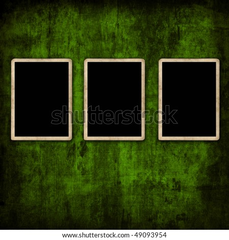 Blank photo frames on green wall