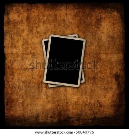 Blank photo frames on grunge background - stock photo