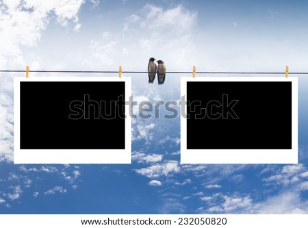 blank photo frames on line with sky background - stock photo