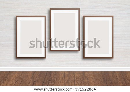 Blank photo frames on the wall, wooden texture, decor conception