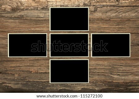 Blank photo frames on wood