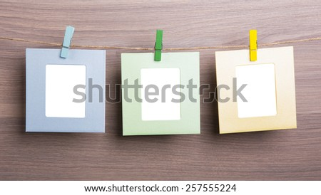 Blank photo frames on wooden background - stock photo