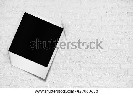 Blank photo papers on wall background with clipping path.