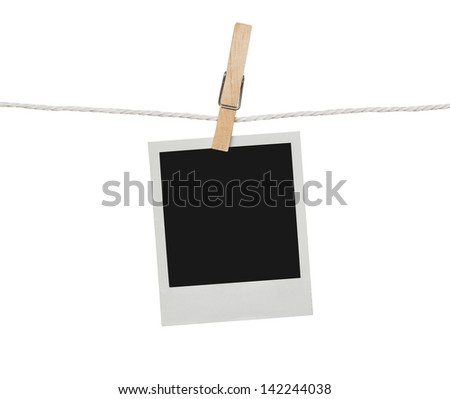 Blank photograph hanging on the clothesline isolated on white background with clipping path for the inside of the frame - stock photo