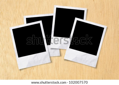 Blank photos frames on wood background