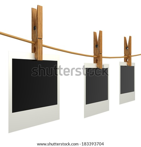 Blank photos hanging on a clothesline. Isolated on white. 3d - stock photo