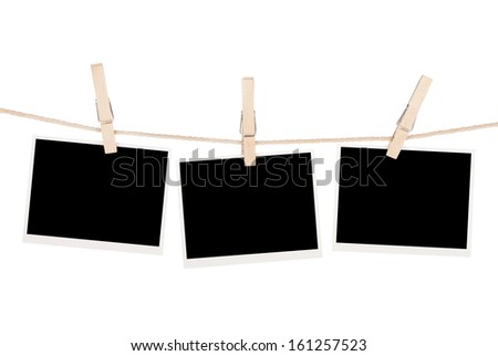 Blank photos hanging on clothesline. Isolated on white background
