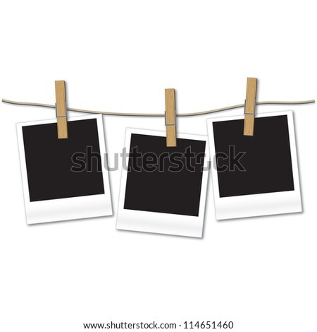 Blank photos hanging on rope - stock photo
