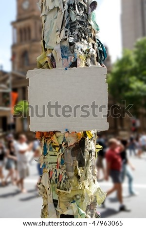 Blank pice of cardboard attached on electric pole city sidewalk on background - stock photo