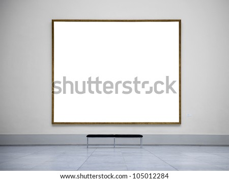 Blank picture frame in empty gallery - stock photo
