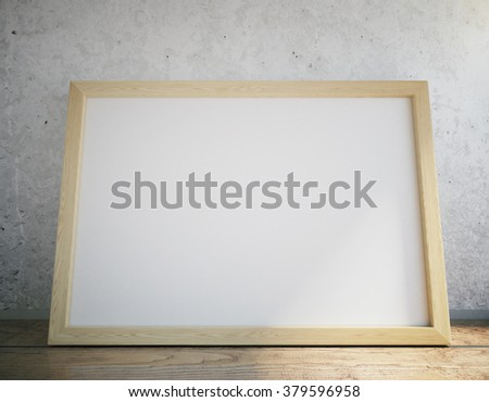 Blank picture frame on wooden table, close up - stock photo