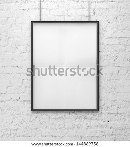 blank picture on a brick wall - stock photo