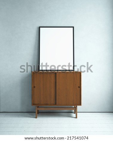 Blank picture on the cabinet in white room - stock photo