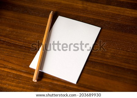 Blank piece of paper and pencil - stock photo