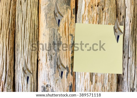 Blank piece of paper attached on a rustic wooden wall with Japanese ninja weapons. Copy space for leaving several messages i.e. command, order, comment, hint, info, news, notification, warning, etc - stock photo
