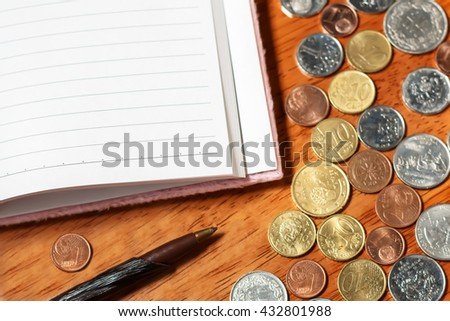 Blank piece of paper with pencil and coins - stock photo