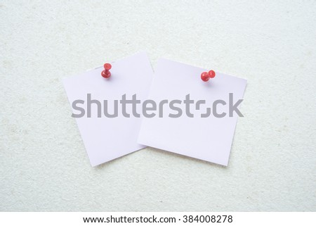 Blank piece paper pinned into brown corkboard - stock photo