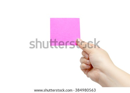 Blank pink note paper in hand isolated on white background