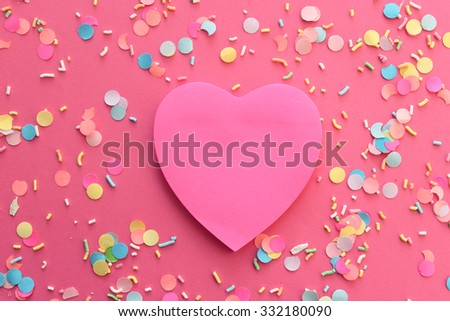 Blank pink paper note heart shape on confetti background with copy space - Valentine day card - stock photo
