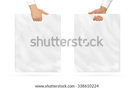 Blank plastic bag mock up holding in hand. Empty polyethylene package mockup hold in hands isolated on white. Pack ready for logo design or mall identity presentation. Food shopping packet handle. - stock photo