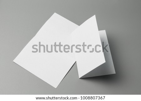 Blank portrait Mock-up paper. changeable background / white paper isolated on gray. identity design, corporate templates, company style, set of booklets, blank white folding paper flyer