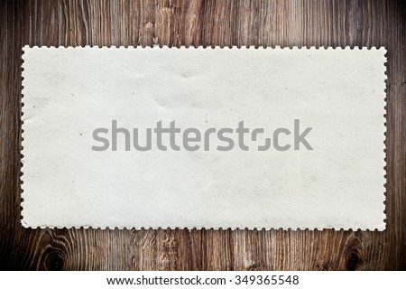 Blank post stamp on wooden background - stock photo